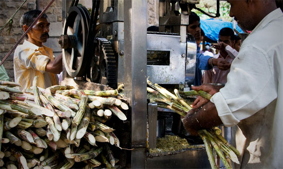 Street vendor preparing cane juice