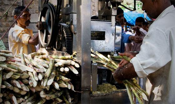 Street vendor preparing cane juice